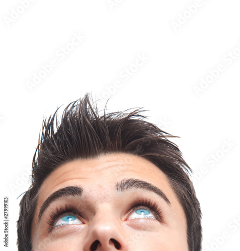 Fotografía  Handsome man with blue eyes looking up isolated on white