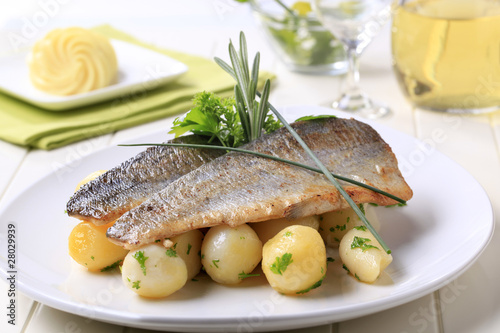 Leinwand Poster Pan fried trout with potatoes