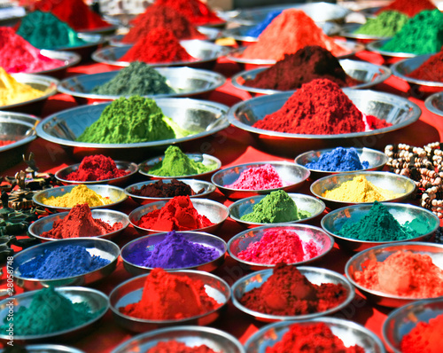 Tuinposter India Colorful tika powders on indian market, India
