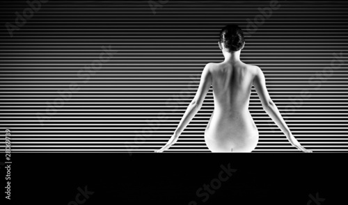 black and white artistic nude; a back silhouette shot on striped