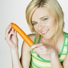 Woman With A Carrot