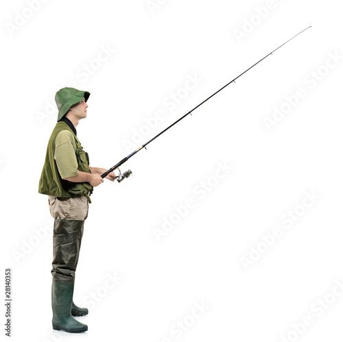 Fotografie, Obraz  Full length portrait of a fisherman holding a fishing pole