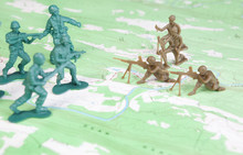 Plastic Army Men Fighting On Topographic Map Two Armies Battle