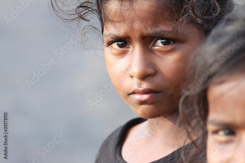 Leinwand Poster Indian Rural Girl with Grim Expression