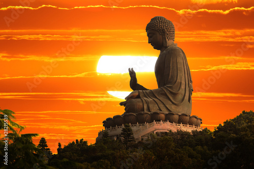 Aluminium Prints China Buddha statue at sunset