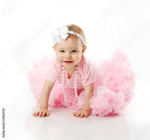 Fotografie, Obraz  Baby girl wearing pettiskirt tutu and pearls crawling