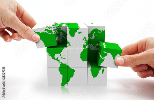 Fotografía  imagen conceptual con puzzle 3d y mapa del mundo