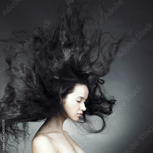 Fototapeta Beautiful woman with magnificent hair