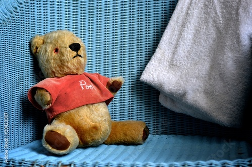 Beloved Winnie the Pooh sits in a chair Canvas-taulu