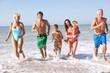 Three generation family play on beach