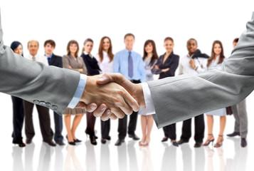 Naklejka handshake isolated on business background