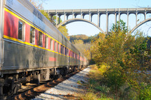Passenger Train Under Arched B...