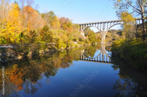 Valokuva  Arched bridge over blue water