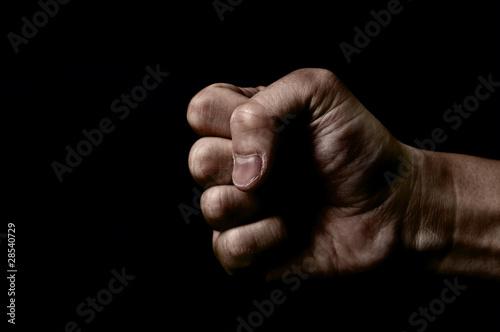 Fotografie, Obraz  黒背景に男性の握った手