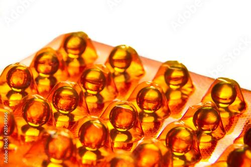 Fototapeta oil capsules