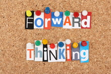 Forward Thinking In Magazine Letters On A Cork Notice Board