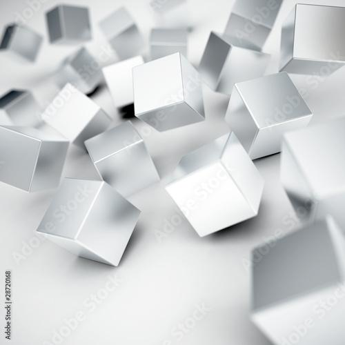 spadajace-i-uderzajace-w-szare-metaliczne-kostki-na-bialym