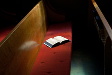 Open Bible Lying On Church Pew...