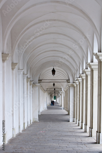 White colonnade with two lovers