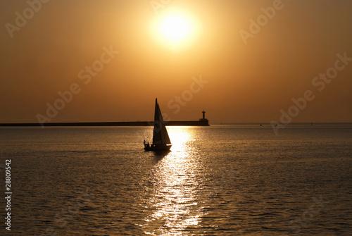 Tuinposter Pier Sail boat against sunset