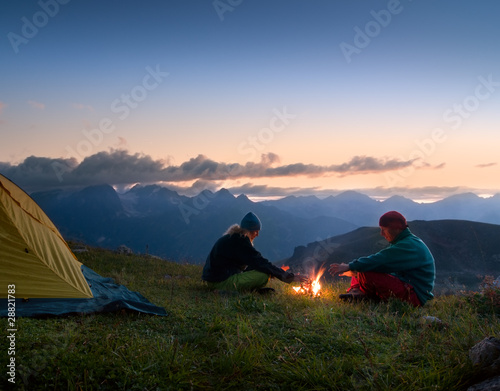 Aluminium Prints Camping couple camping at night