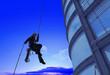 Leinwandbild Motiv Man on a skyscraper