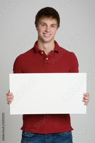 Fotografering  Attractive teenage boy holding a blank sign