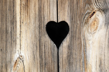 Detail Of A Wooden Door With Heart Decoration