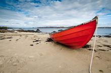 Small Rowboat Lying At Shore