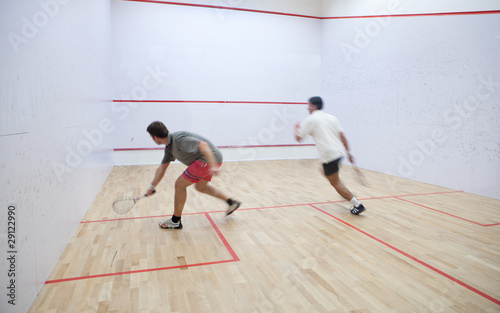 Fotografiet  Squash players in action on a squash court (motion blurred image