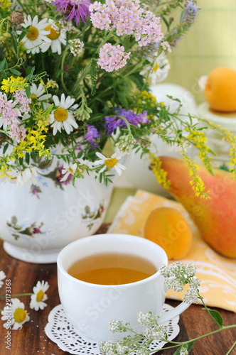 Field flowers and herbal tea (background)