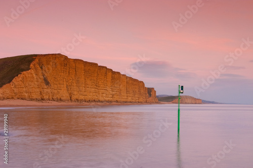 Photo  Golden sandstone cliffs , Dorset, UK