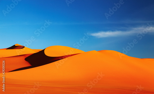 Foto op Plexiglas Zandwoestijn Sand dune in Sahara Desert at sunset