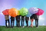 Fototapeta Tęcza - seven friends with rainbow color umbrellas on meadow collage
