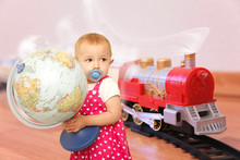 Child With Baby Dummy And Globe Wants Trip On Toy Train Collage