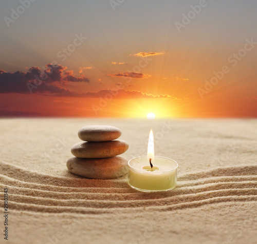 Acrylic Prints Stones in Sand stack of stones and candle light