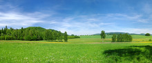 Green Meadow And Blue Sky During The Spring