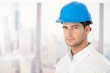 Handsome young engineer in hardhat