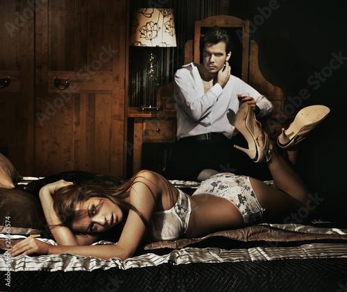 Nowoczesny obraz na płótnie Two adult people in bedroom posing