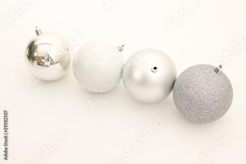 Silberne Weihnachtskugeln.Vier Silberne Weihnachtskugeln Buy This Stock Photo And