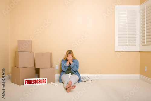 Upset Woman on Floor Next to Boxes and Foreclosure Sign Canvas Print