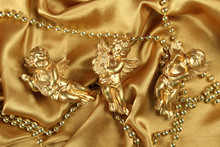 Three Small Gold Angel