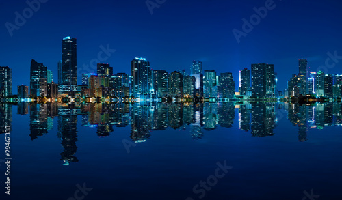 Miami skyline night panorama with beautiful reflections
