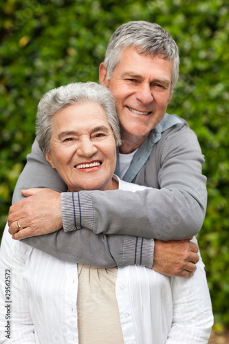 Fototapety, obrazy: Mature couple hugging in the garden