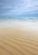 marine beach scene with sand ripples and very beautiful sky