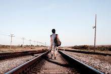 Teen Boy With Problems Walking On Rail Road