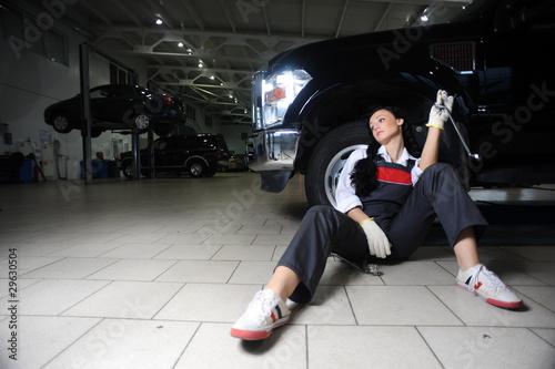 фотография  boring young girl in repair centre