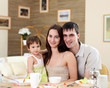 young family at home having meal