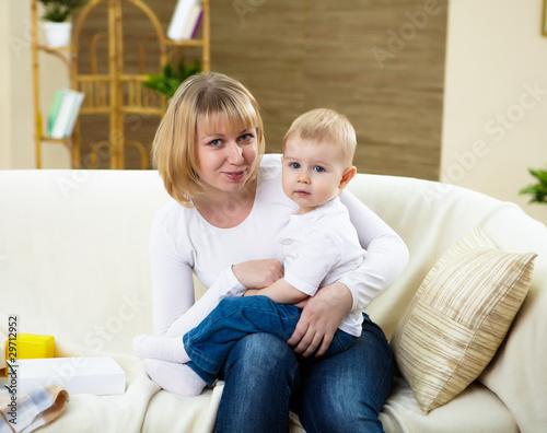 Fototapeta little boy and his mother at home together obraz na płótnie