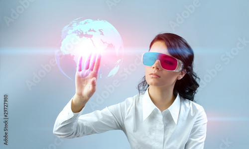 Платно Touching 3D globe. Brunette in anaglyph stereo glasses.